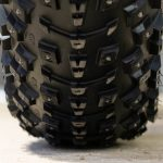 close up of studded fat bike tire with no rider on bike